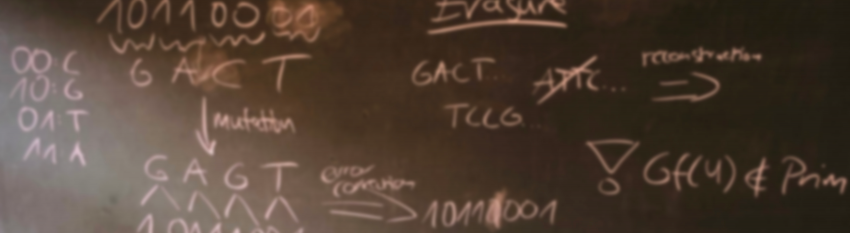 Photo showing a chalcboard with notes on DNS and binary code written on it