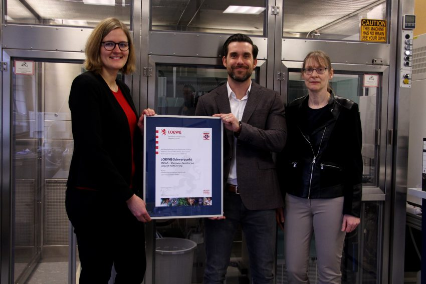 LOEWE certificate handover. Left to right: Maya Gradenwitz, Dominik Heider, Anke Becker